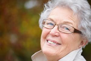 Autumn - Senior woman beside copyspace